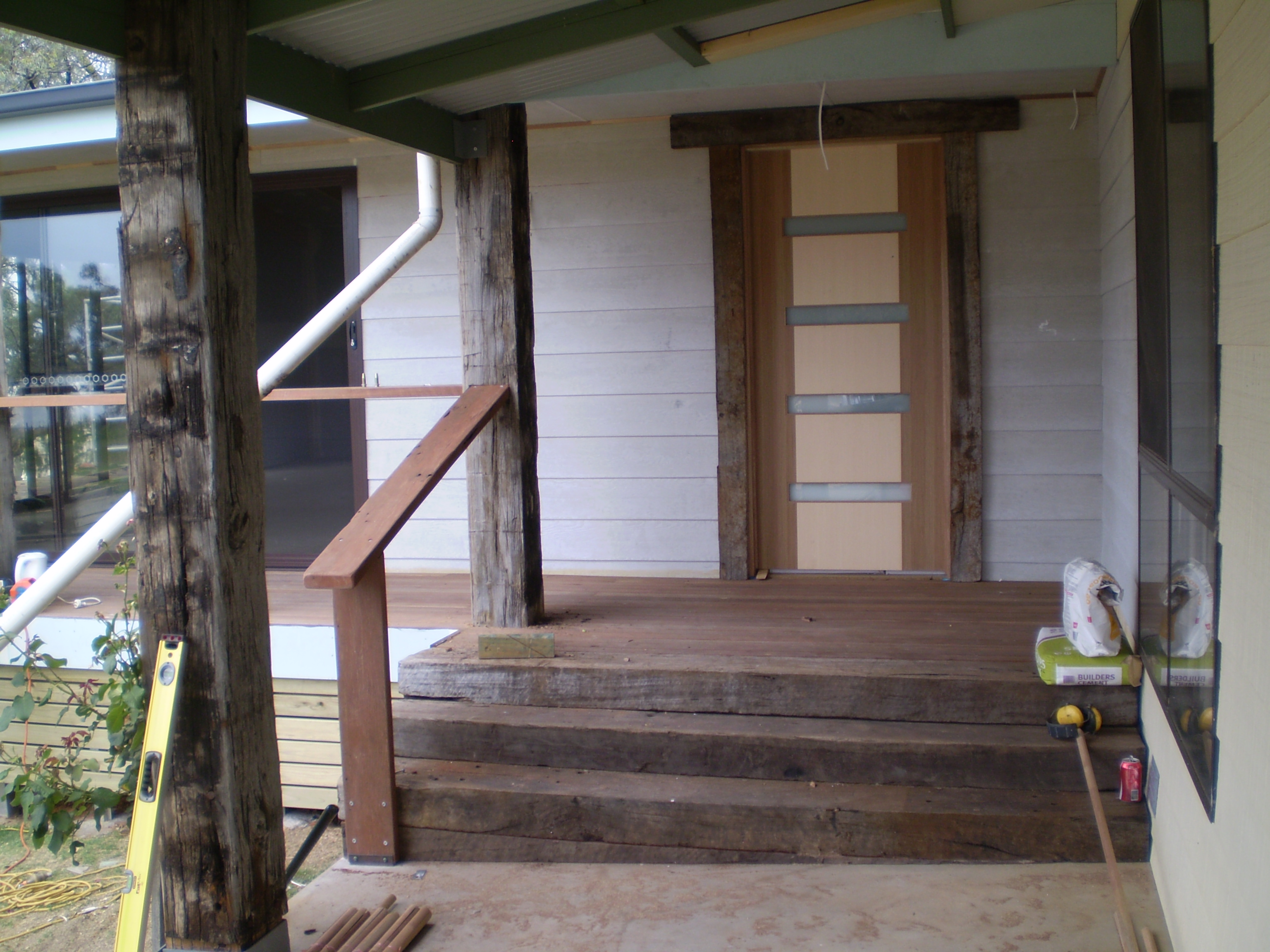 Timber stairs, posts, hand rail and new door.